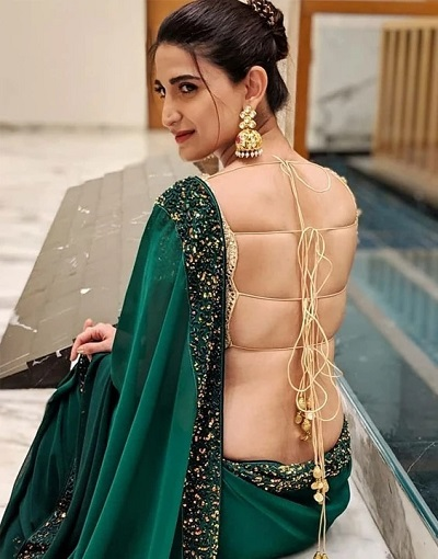 Top 10 Latest Backless Blouse Designs For Sarees & Lehengas .