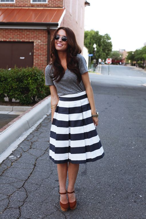 Wear gray with a black and white striped skirt like this .