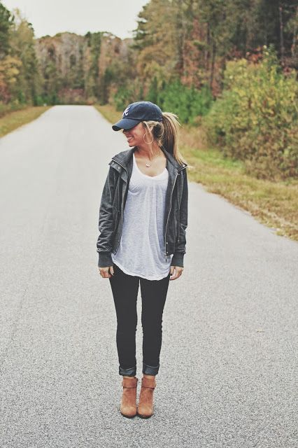 casual baseball cap with loose shirt, skinny jeans and boots .