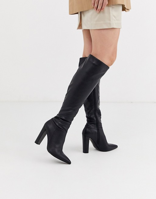 ASOS DESIGN Coral heeled knee high boots in black | AS