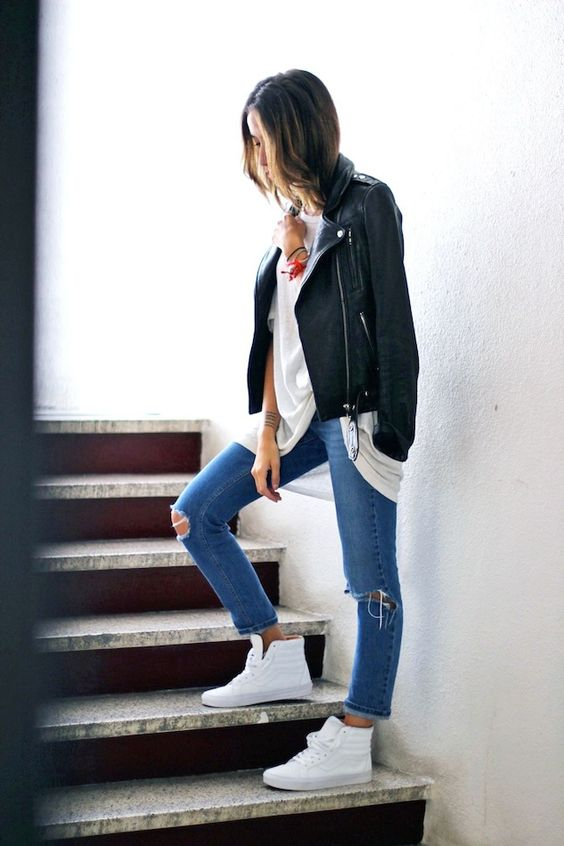Picture Of white hightop vans outfit with blue denim and a leather .