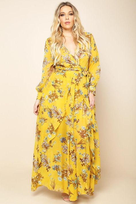 A plus size maxi dress with a wrapped V-neckline and long sleeves .