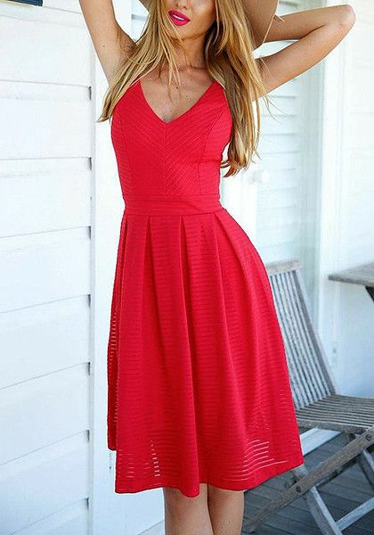 This red V neck sundress features a pleated knee-length skirt and .
