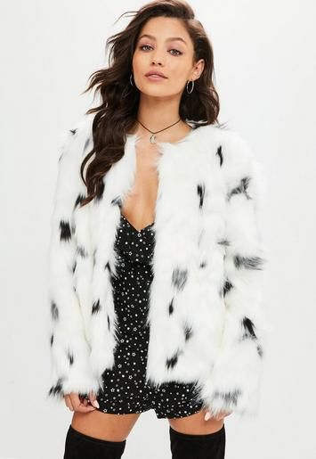 This white faux fur coat features black leopard spots, open front .